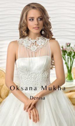 Стильное свадебное платье силуэта «принцесса» с ажурной отделкой на спинке.