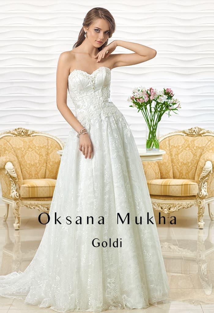 Фактурное свадебное платье «принцесса» с кружевной юбкой и изящным корсетом.