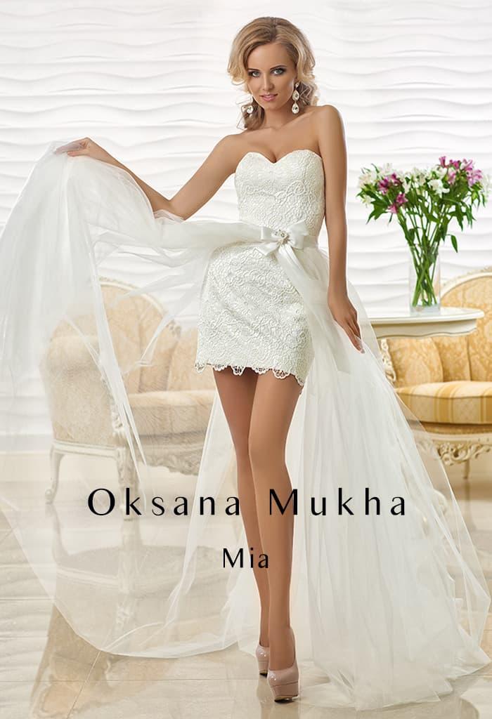 89fe45e9496 Соблазнительное свадебное платье длиной до середины бедра с прозрачной  верхней юбкой.