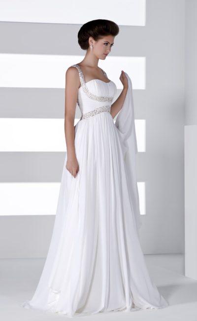 Изысканное свадебное платье в ампирном стиле с бисерной отделкой под лифом и на бретелях.