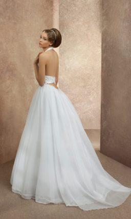 Свадебное платье с американской проймой, широким поясом и юбкой А-силуэта.