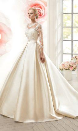 Пышное свадебное платье с атласной юбкой и ажурной отделкой верха.