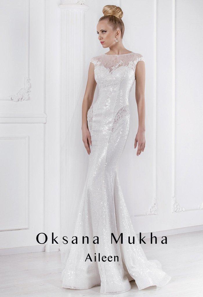 Роскошное свадебное платье с облегающим силуэтом «рыбка» со сверкающей отделкой пайетками.