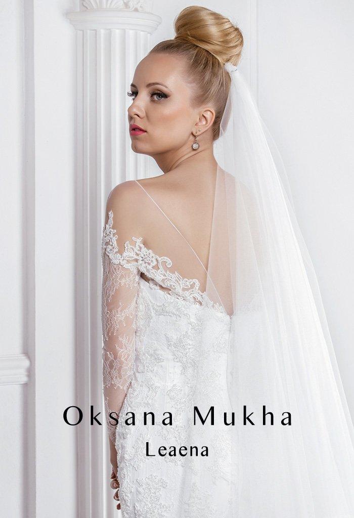 Нежное свадебное платье с силуэтом «рыбка», длинным рукавом и кружевной отделкой.