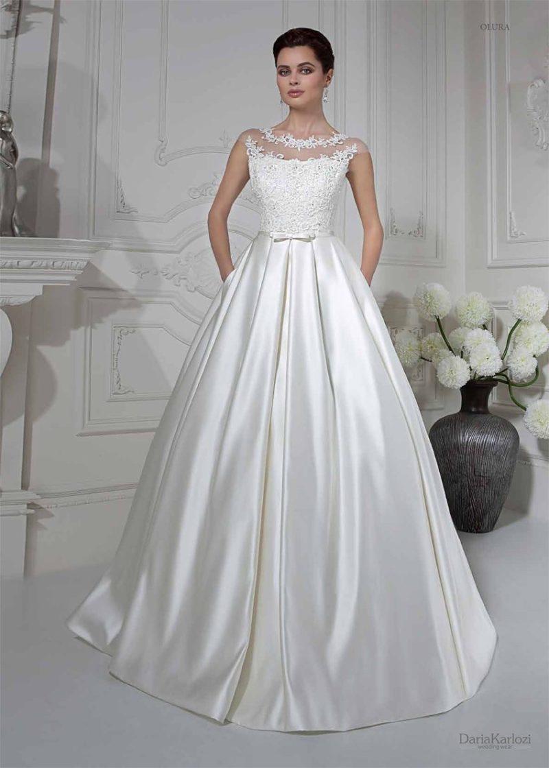 Cвадебное платье с атласной юбкой со скрытыми карманами.