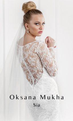 Кружевное свадебное платье силуэта «рыбка» с длинными облегающими рукавами.