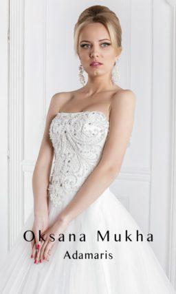 Свадебное платье «принцесса» с многослойной юбкой и вышивкой крупным бисером на лифе.