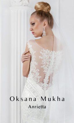 Стильное свадебное платье силуэта «рыбка» с вышивкой на лифе и полупрозрачной вставкой.