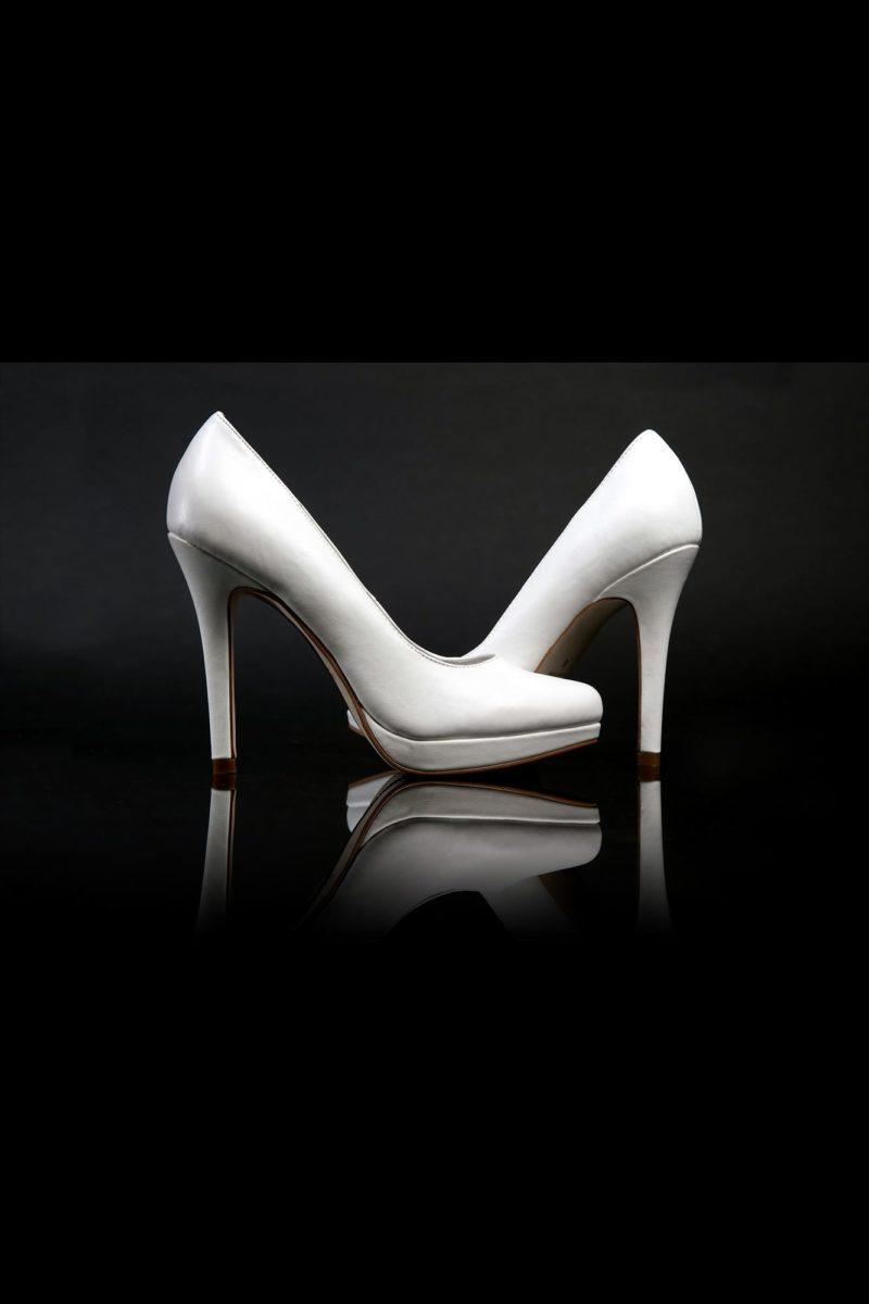 Стильные кожаные туфли с платформой в носочной части и каблуком 12 см.