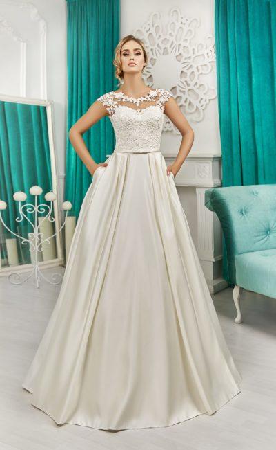 Свадебное платье силуэта «принцесса» со скрытыми карманами и ажурным верхом.