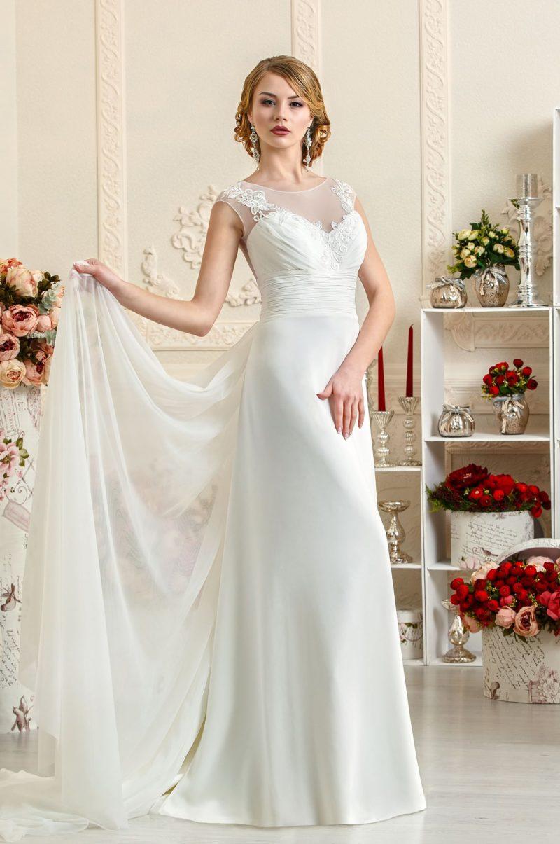 Закрытое свадебное платье в ампирном стиле с длинным прозрачным шлейфом.