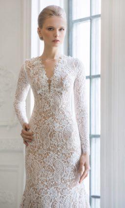 Свадебное платье с иллюзией прозрачности, длинными рукавами и юбкой «русалка».