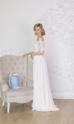 Деликатное свадебное платье прямого силуэта, украшенное кружевом по лифу с портретным вырезом.