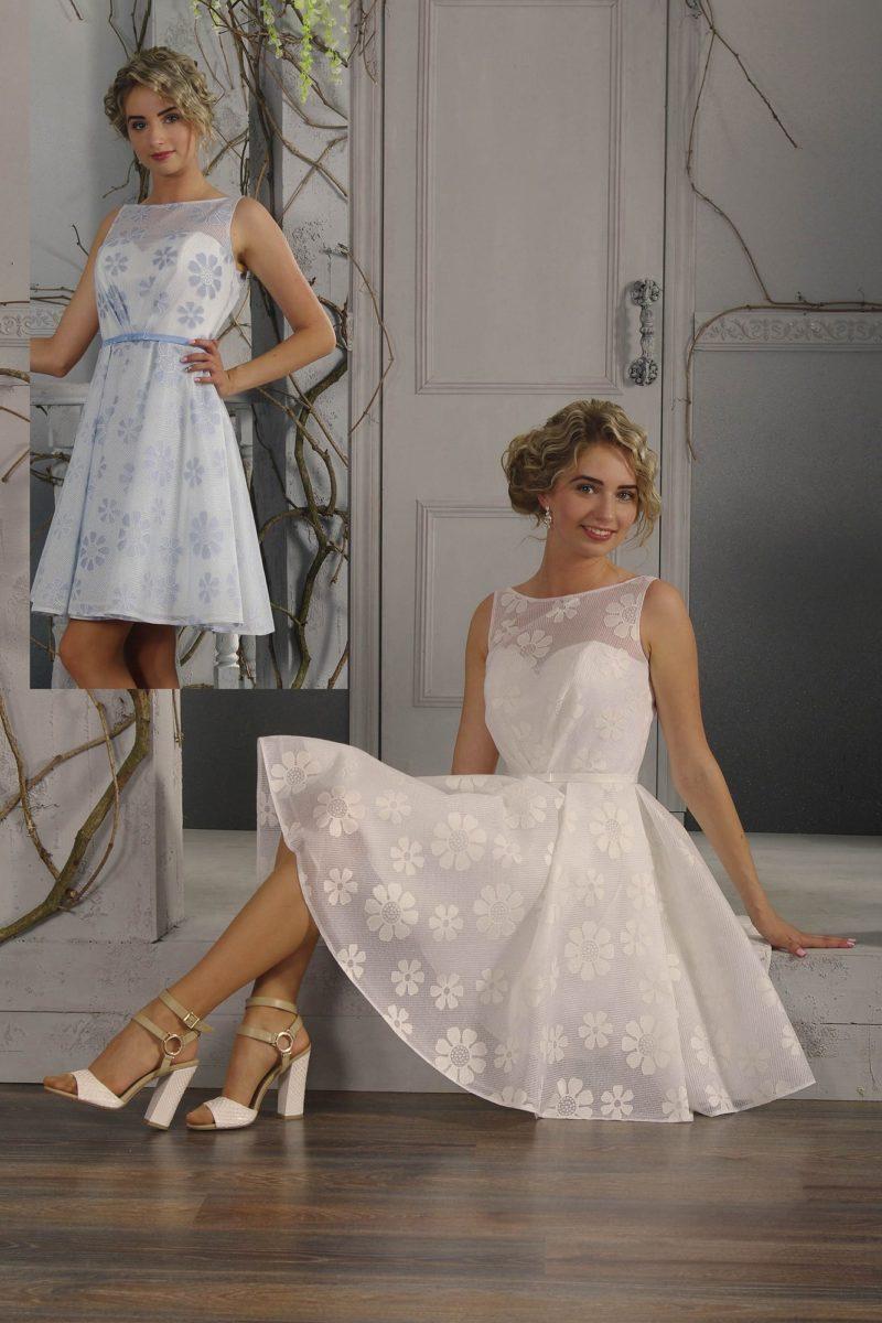 Короткое свадебное платье из двухслойной ткани с верхом, покрытым цветочным рисунком.