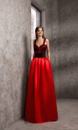 Алое вечернее платье с прямой линией декольте и длинной многослойной юбкой.
