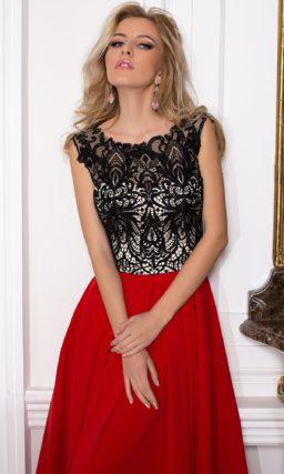 Вечернее платье с длинной алой юбкой и белым корсетом под контрастным черным кружевом.