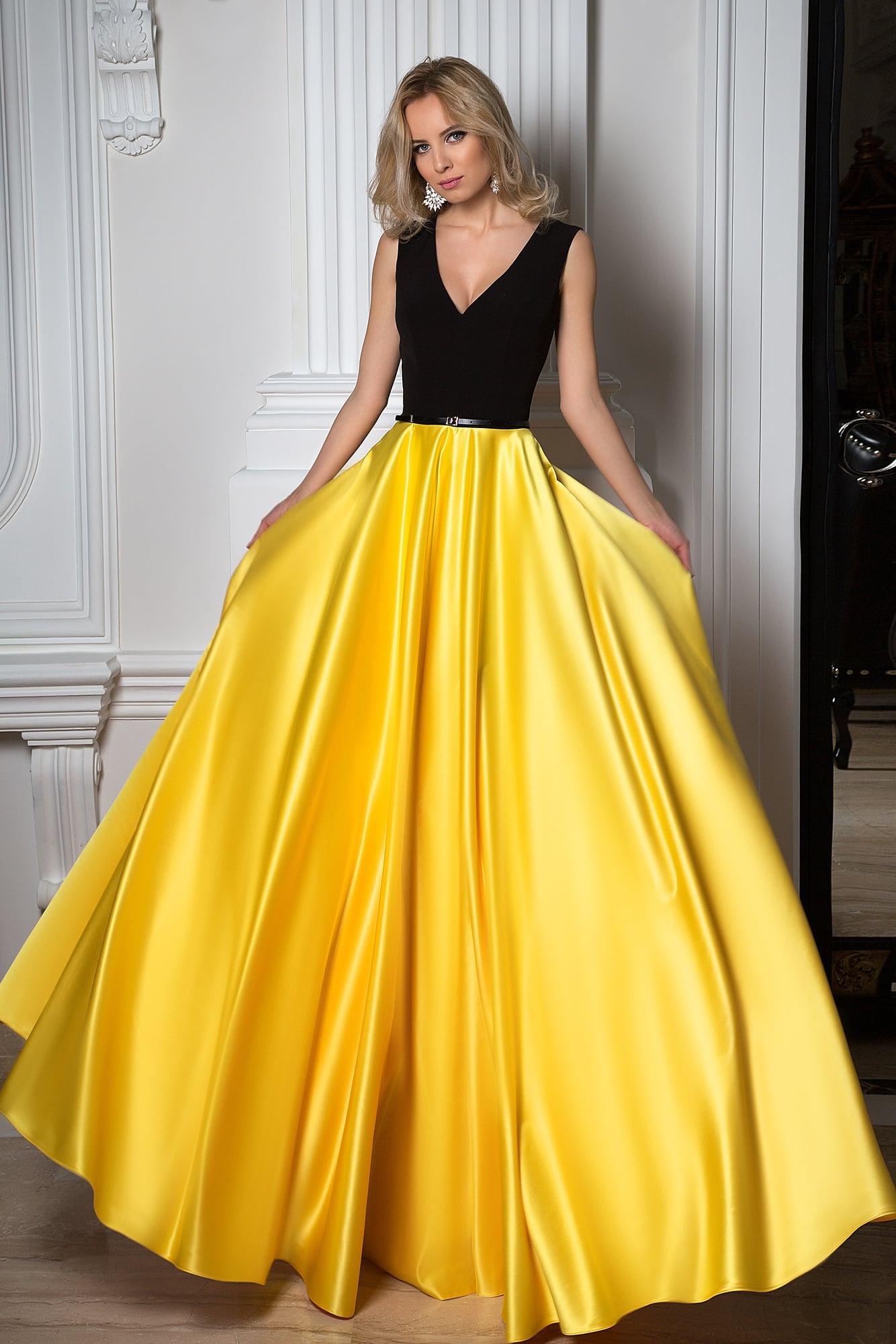 Роскошное вечернее платье с яркой желтой юбкой и лифом из матовой черной ткани.