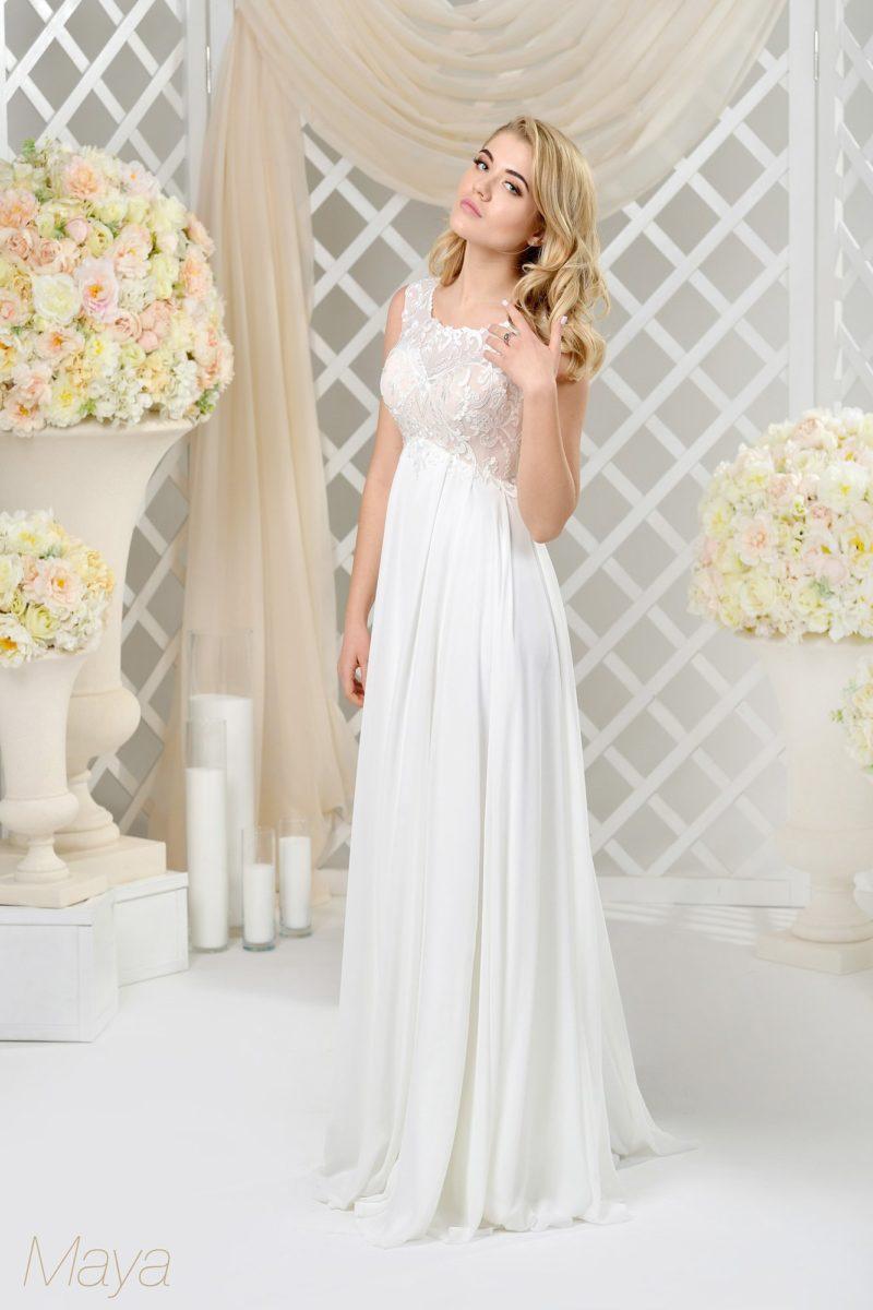 Ампирное свадебное платье с лифом в бежевых тонах и белоснежной легкой юбкой.