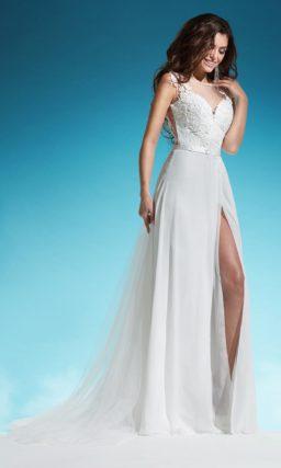 Деликатное свадебное платье «трапеция» с закрытым лифом и коротким рукавом.