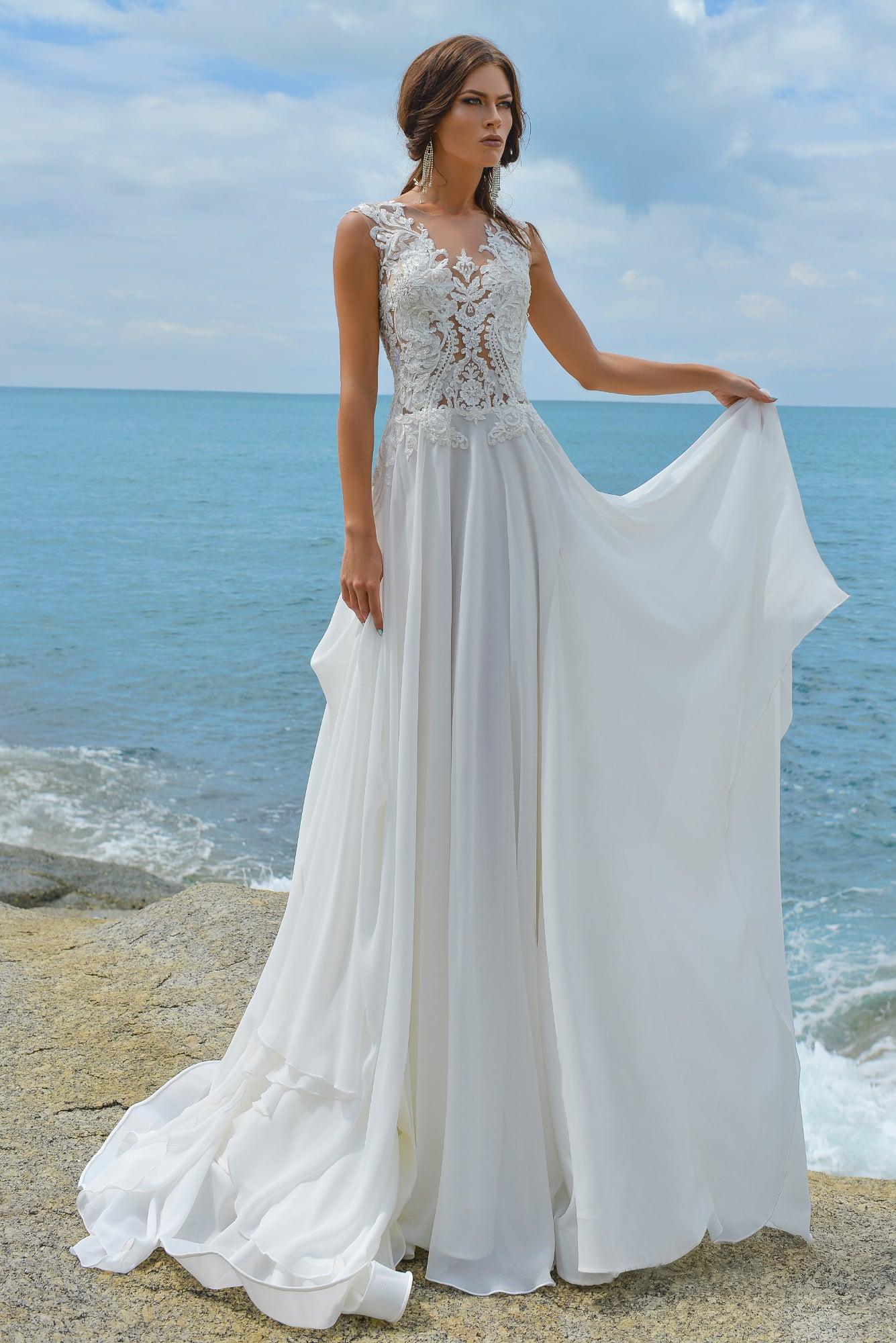 3197c90241006f0 Прямое свадебное платье с шифоновой юбкой и тонким кружевным верхом.