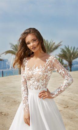 Изысканное свадебное платье с белой юбкой и закрытым верхом.