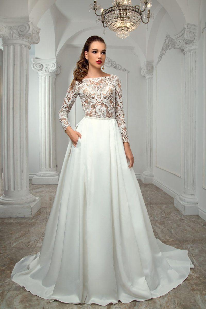 Свадебное платье «принцесса» с кружевным верхом на бежевой подкладке в тон кожи.