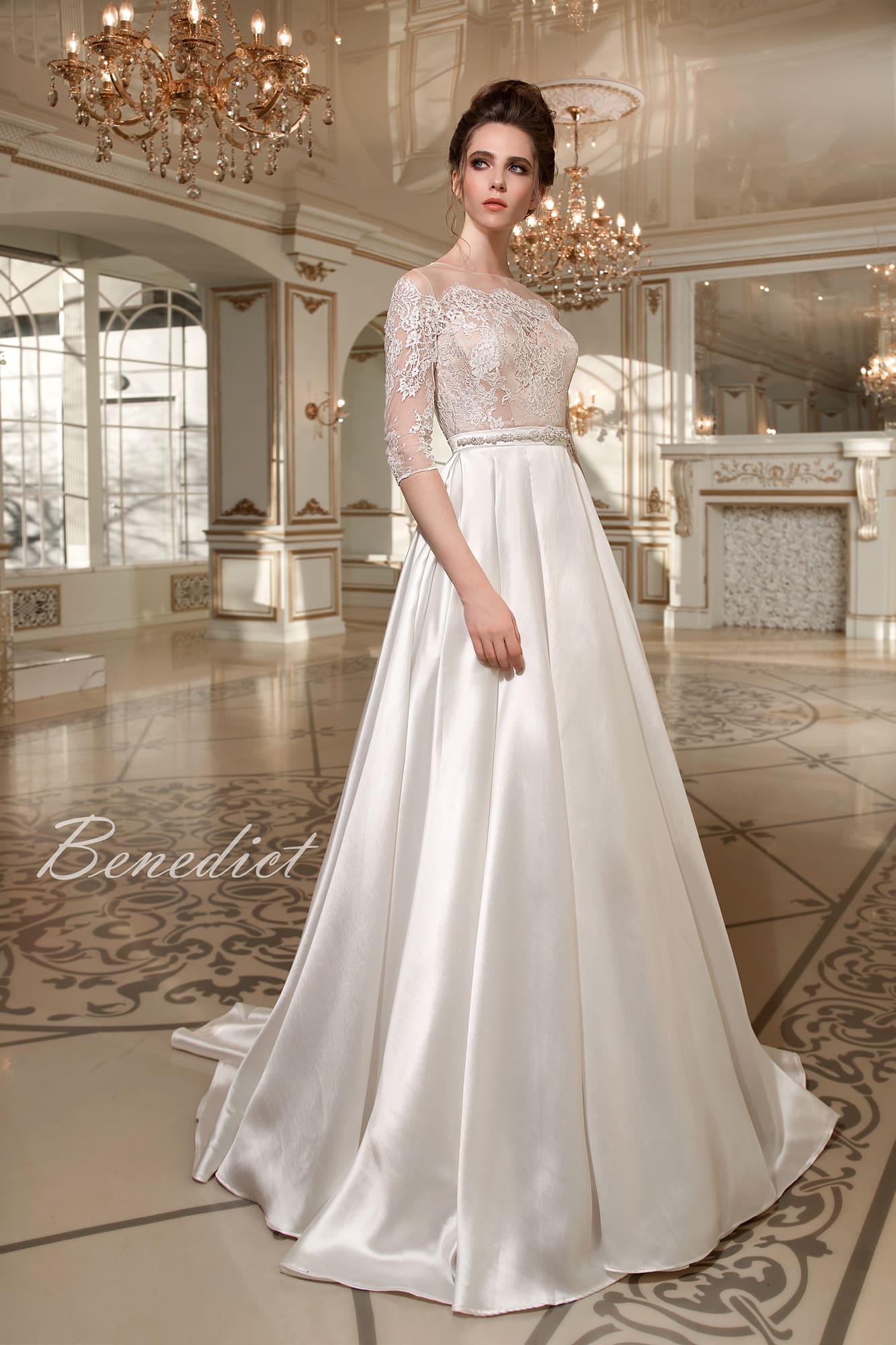 356e06b51d9 Свадебное платье с атласной юбкой А-силуэта и женственным кружевным верхом  с длинным рукавом.