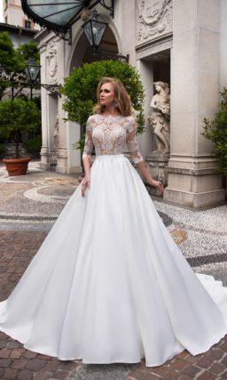 Эффектное свадебное платье с иллюзией полупрозрачности по верху и юбкой А-силуэта.