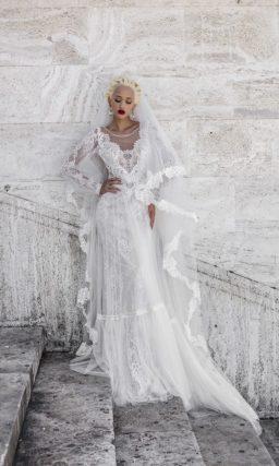 Прямое свадебное платье с кружевной юбкой и необычным длинным рукавом из тонкой ткани.