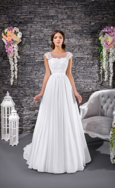 Стильное свадебное платье «принцесса» с широкими бретелями и поясом на талии.