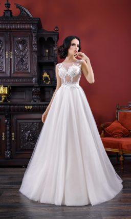 Оригинальное свадебное платье силуэта «принцесса» с полупрозрачным лифом с кружевом.