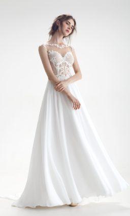 Свадебное платье с верхом с иллюзией прозрачности и вырезом на спинке.