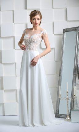 Прямое свадебное платье с полупрозрачным верхом и деликатной открытой спинкой.
