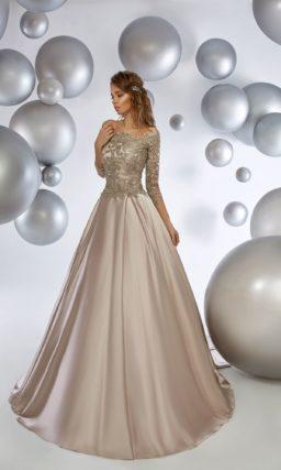 Золотистое вечернее платье с пышной юбкой и кружевным болеро.