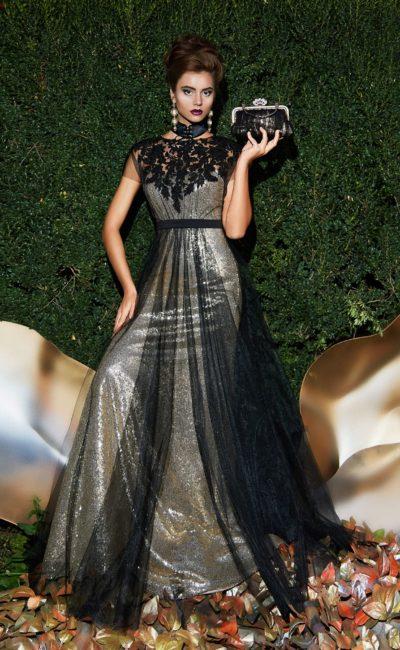 Сияющее вечернее платье с полупрозрачным черным верхом и кружевным декором.