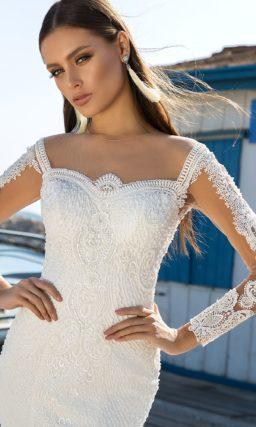 Свадебное платье «рыбка» с открытой спинкой с прозрачной вставкой.