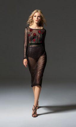 Черное вечернее платье с цветочным декором и иллюзией прозрачности.