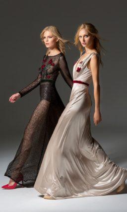 Черное вечернее платье с длинным рукавом и открытой спинкой.