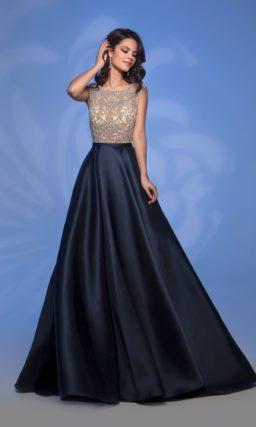 Черное вечернее платье с сияющим бежевым лифом.