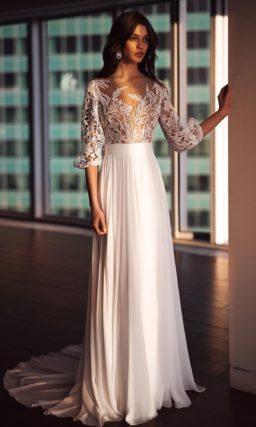 Свадебное платье с длинным прозрачным рукавом и бежевым корсетом.