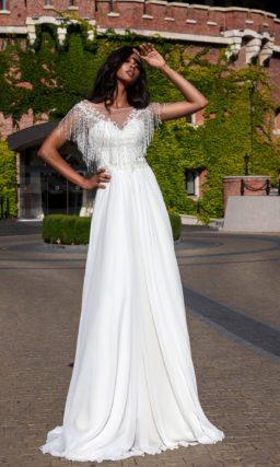 свадебное платье с элементами стиля бохо и лаконичным дизайном