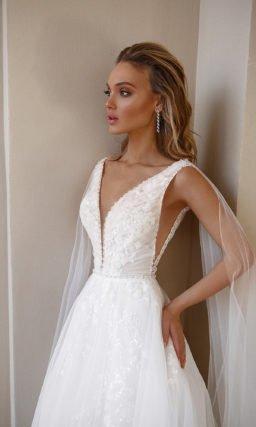 Свадебное платье декорированное мерцающей вышивкой